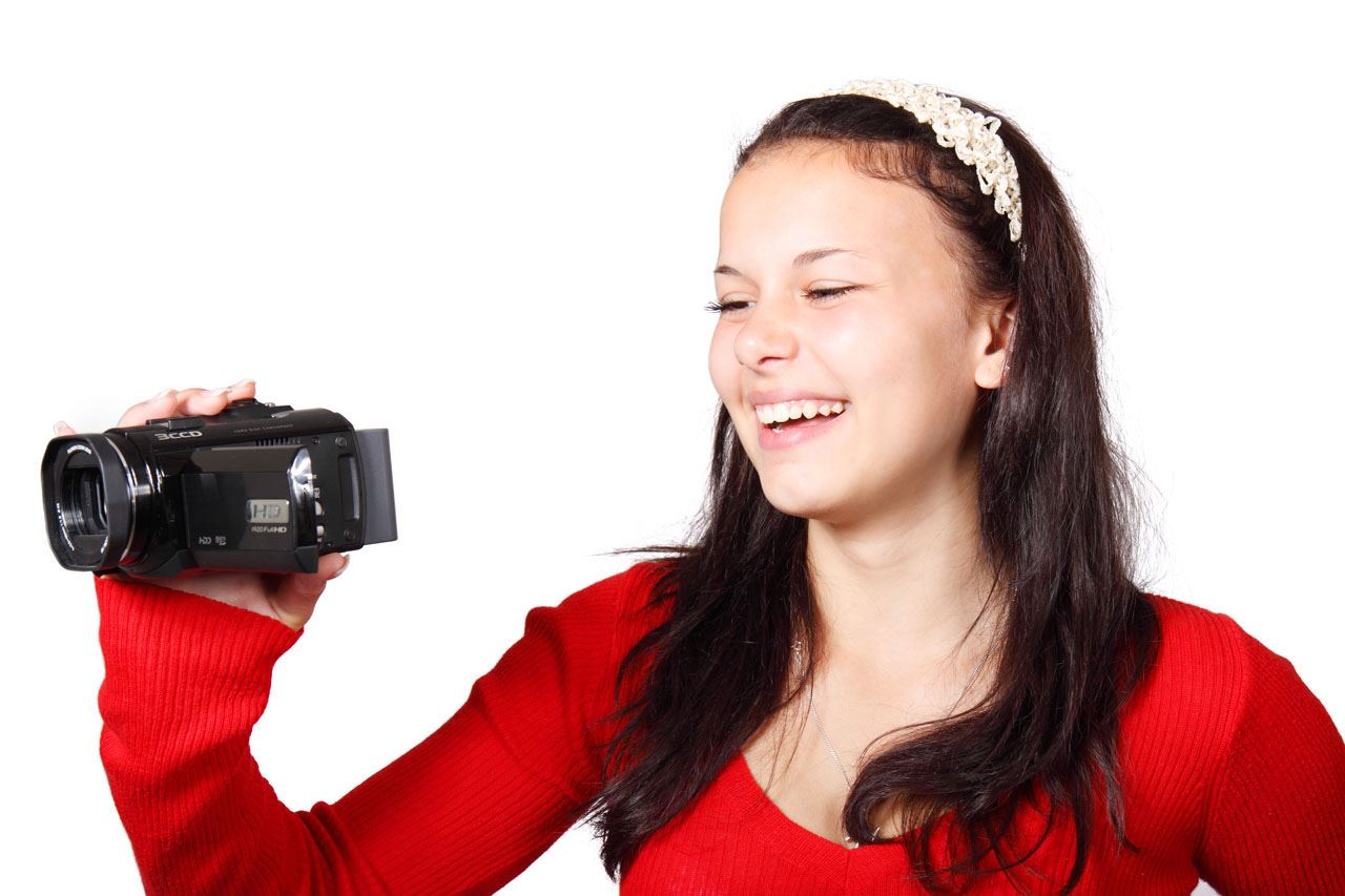 Teen using video camera public domain image