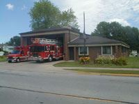 Exterior of Fire Station 3 with parked fire trucks