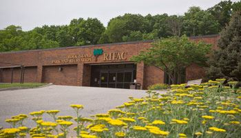 Exterior of Fitness & Activity Center with flowers